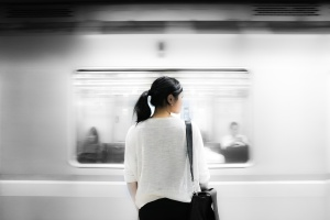 Asian Girl Waiting for Passing Train
