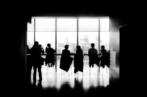 Group people in conference room with window
